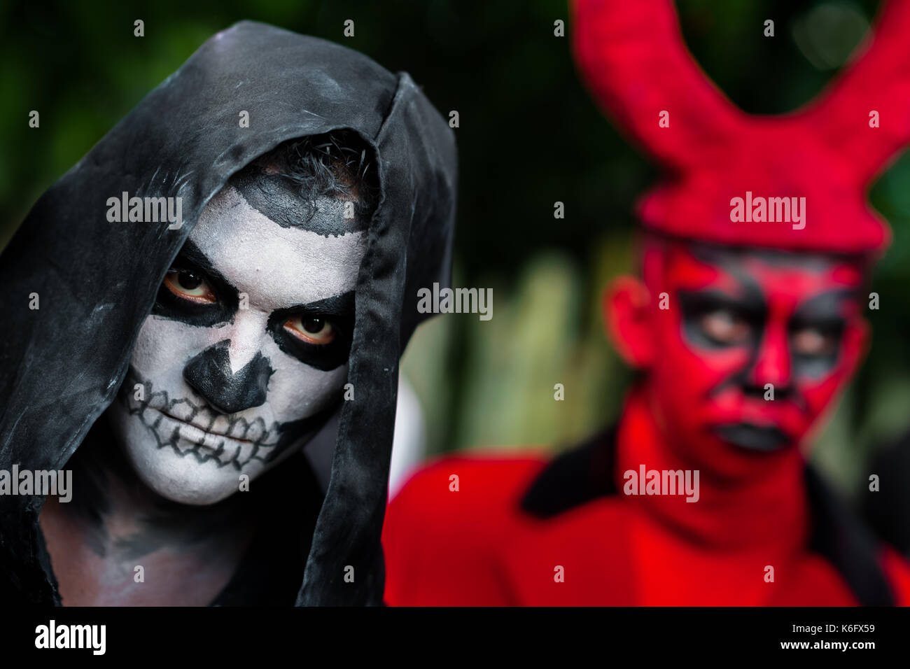 A young Salvadoran man with skull face paint takes part in the La Calabiuza parade at the Day of the Dead celebration in Tonacatepeque, El Salvador, 1 - Stock Image