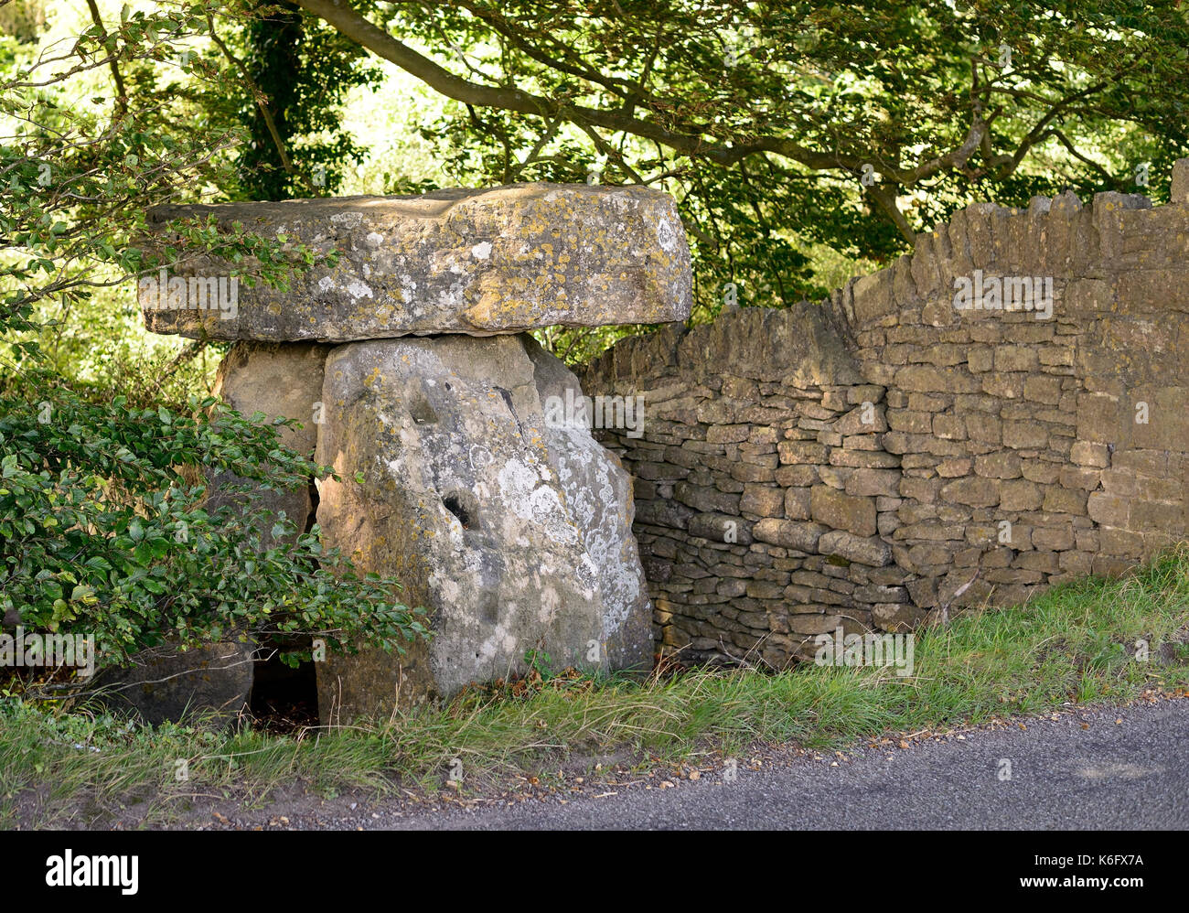 The Three Shire Stones, beside the route of the Fosse Way Roman road, which is now a minor tarmac road heading north Stock Photo