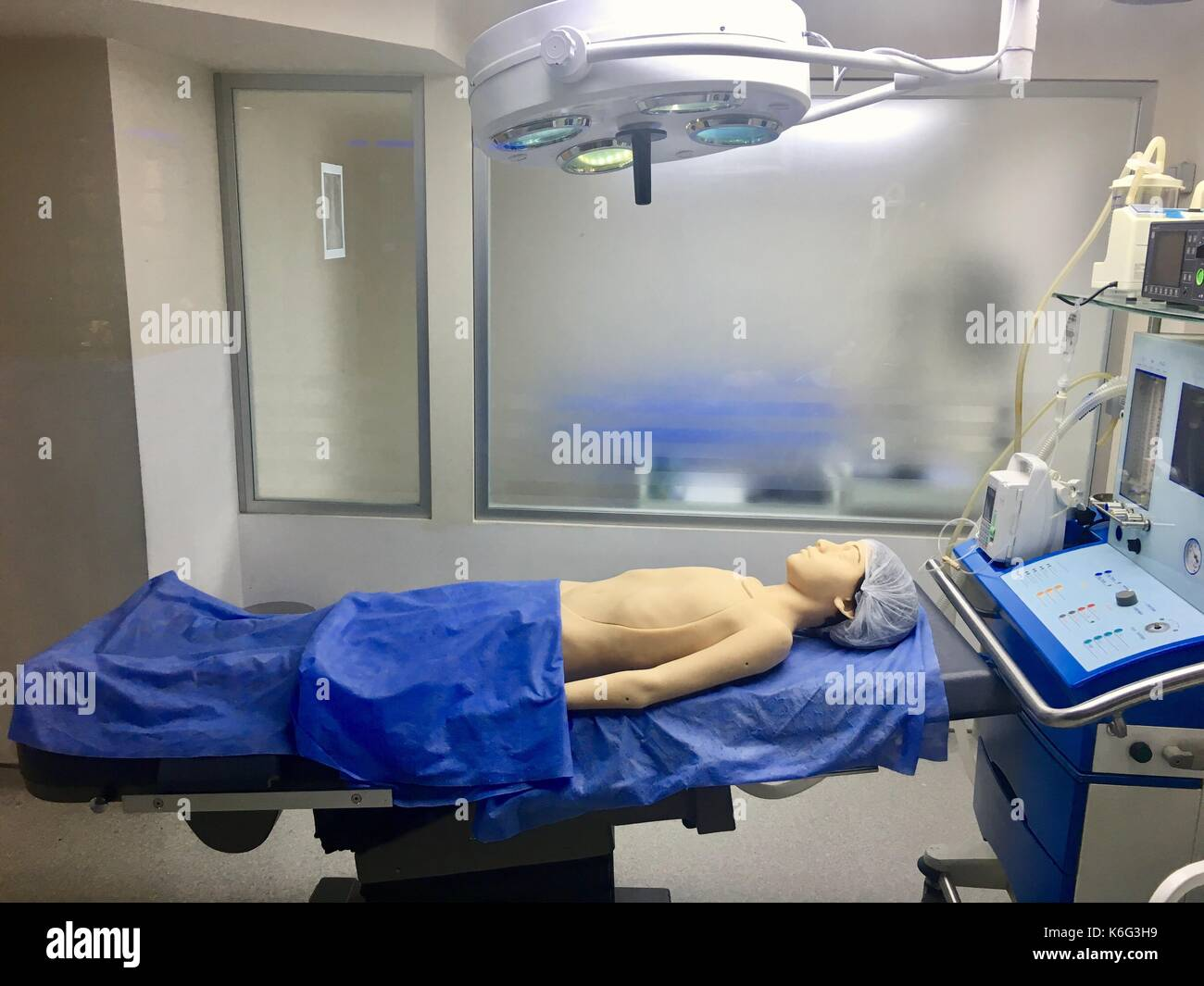 artificial wax model in modern operating room with Defibrillator equipment for training, educational - Stock Image