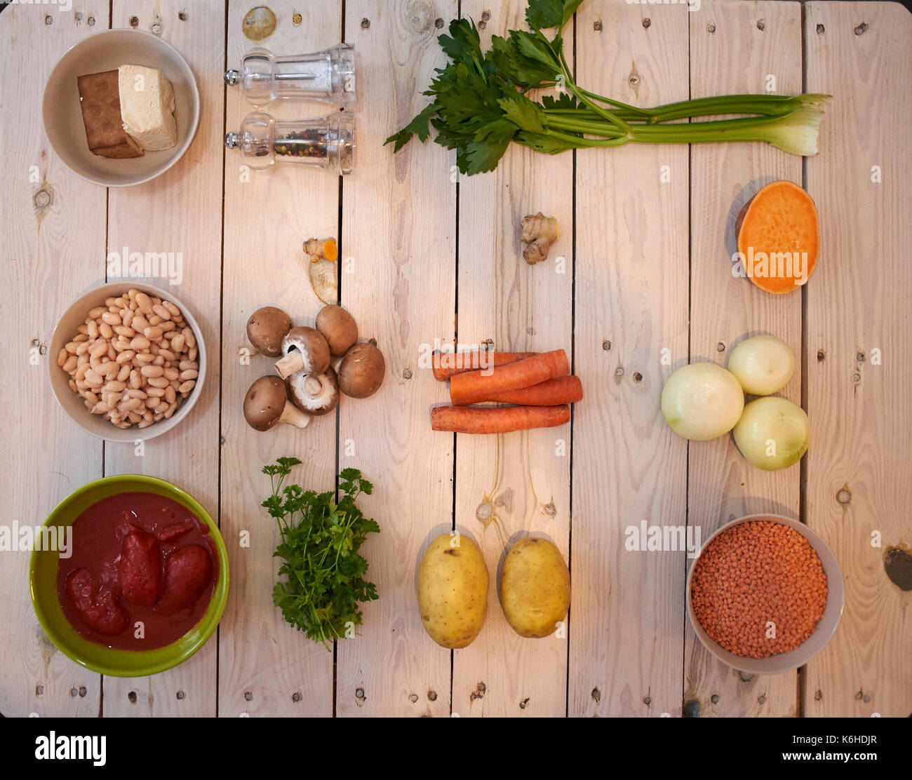Vegetables and tofu counted on a table prepared for cooking a vegan dish - Stock Image