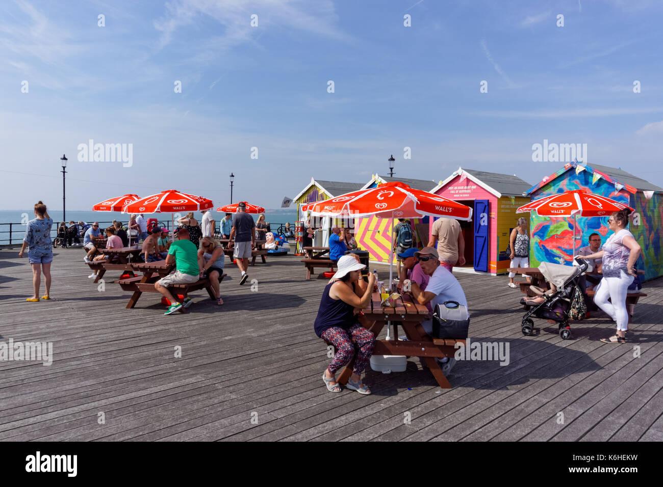People enjoy sunny day on the Southend Pier, Southend-on-Sea, Essex, England, United Kingdom, UK - Stock Image