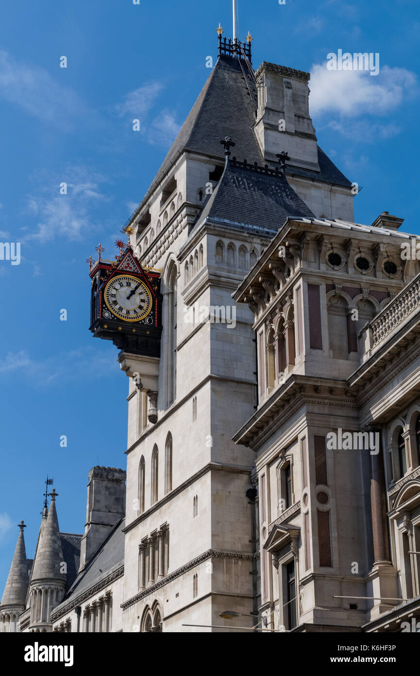 The clock tower of the Royal Courts of Justice, London, England, United Kingdom, UK - Stock Image