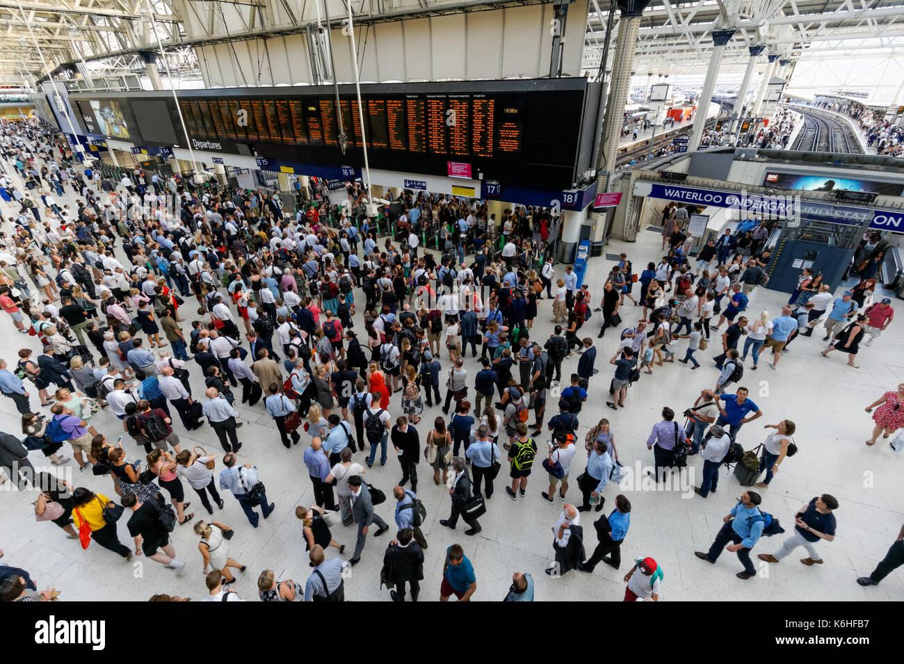 Passengers at Waterloo Station wait for delayed trains, London, England, United Kingdom, UK - Stock Image