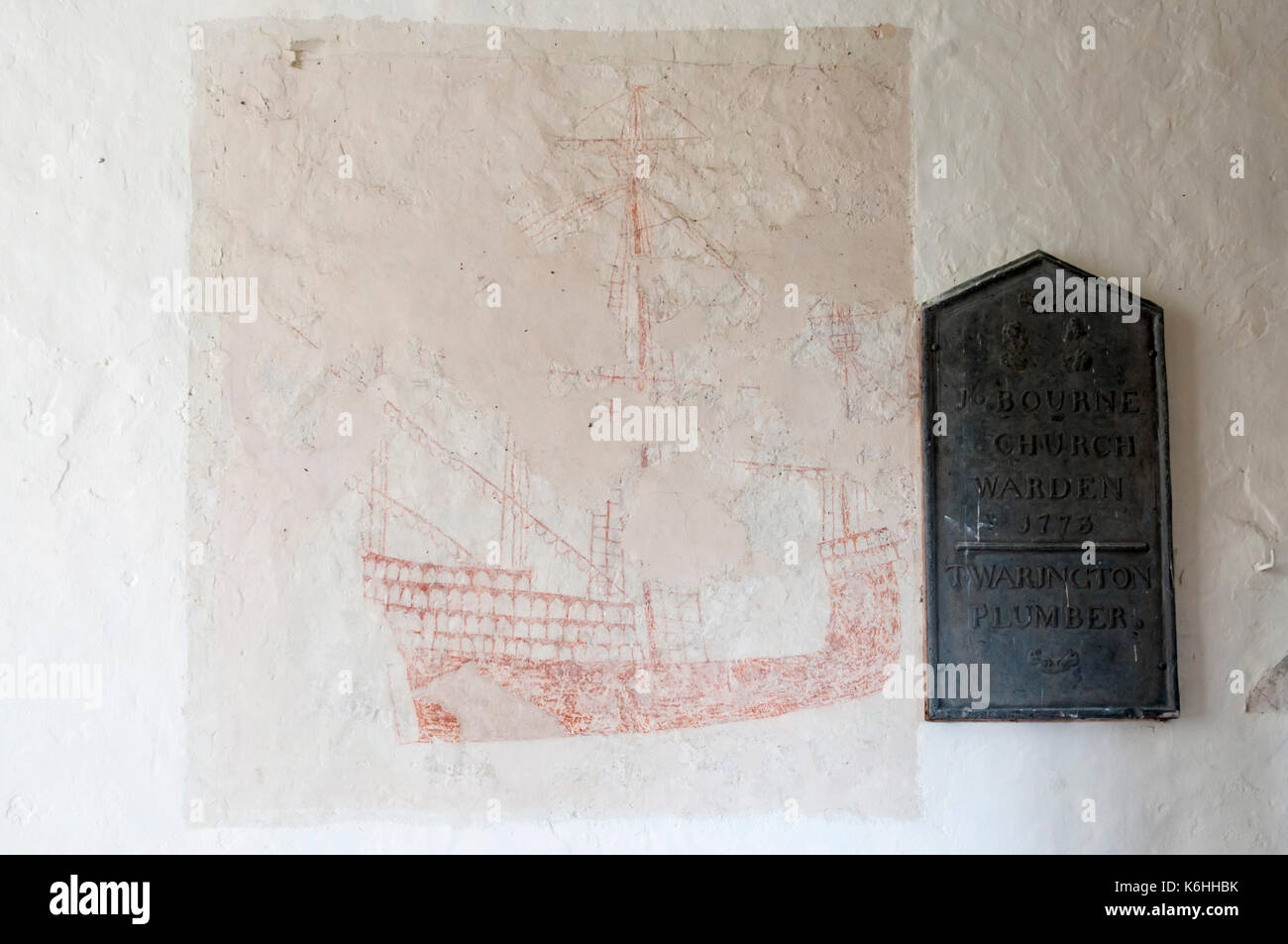Fifteenth century painting of sailing ship on wall of Snargate church, Romney Marsh, Kent - Stock Image