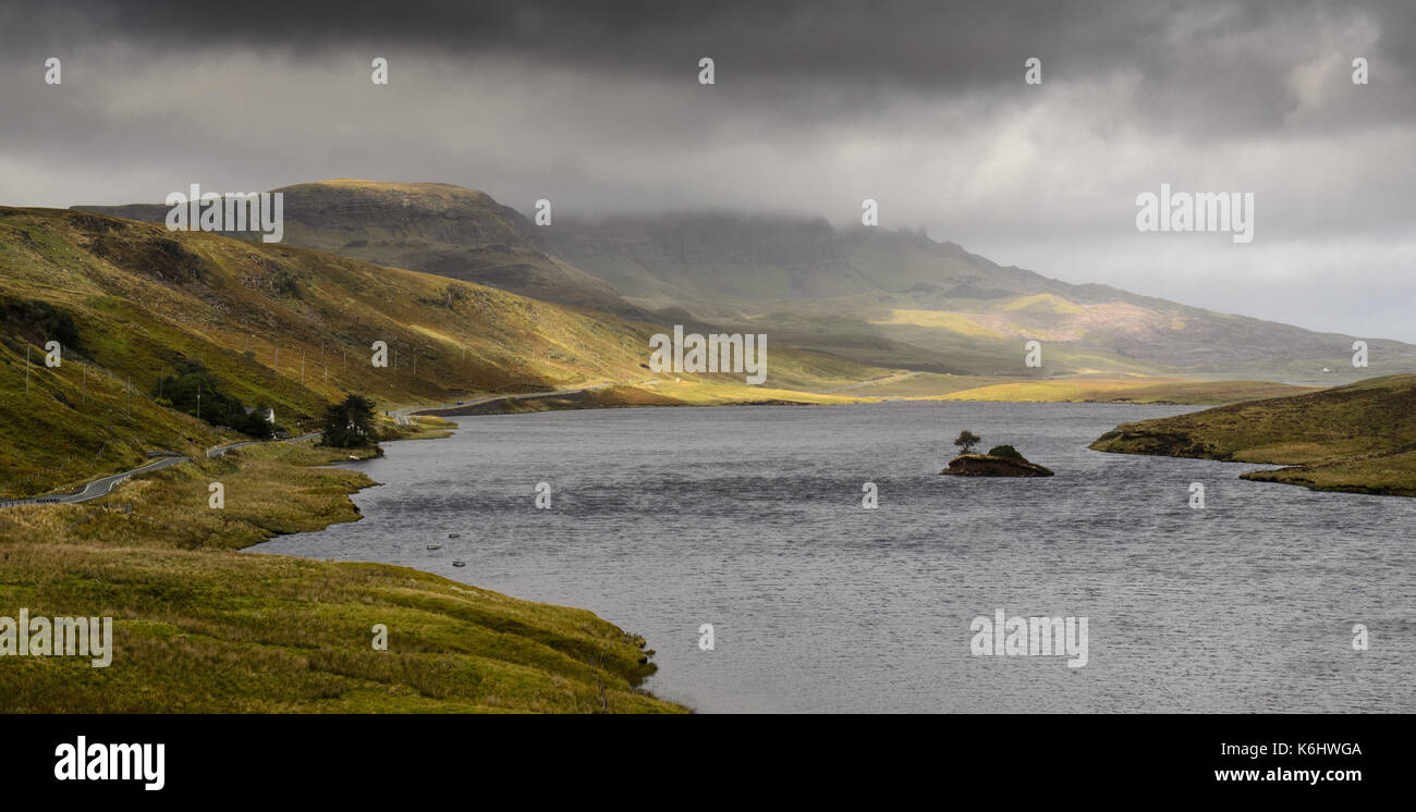 The Storr Lochs hydroelectric reservoir lakes nestled under the mountains of the Trotternish Peninsula on the Isle of Skye in the West Highlands of Sc - Stock Image