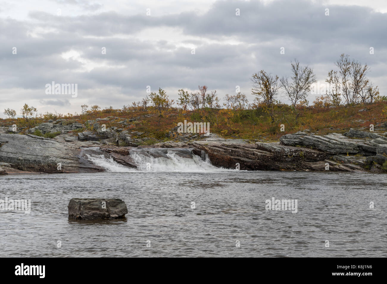 Autumn at the mountain in Alta Finnmark with a tiny waterfall - Stock Image