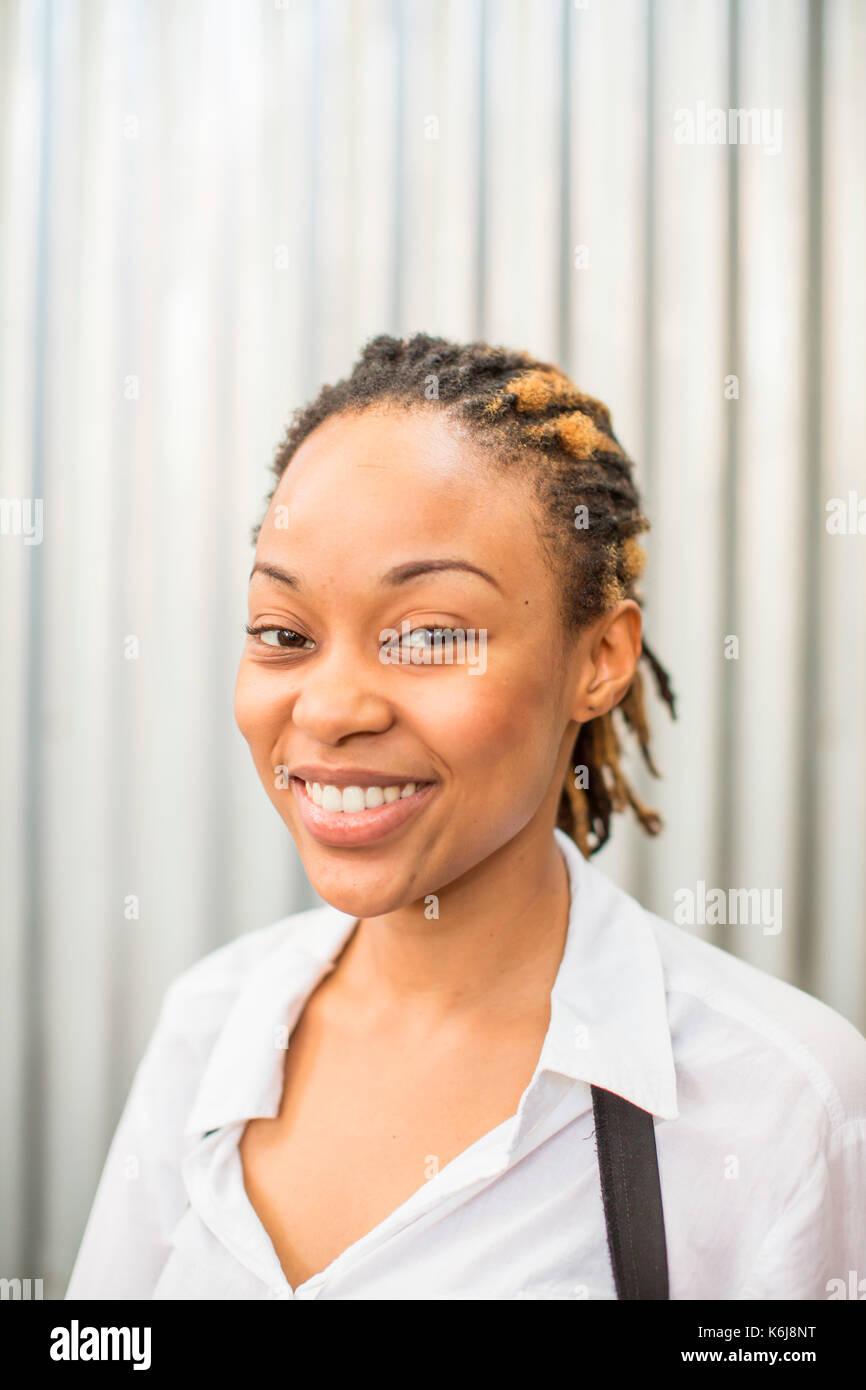 Portrait of female waiter, Durban, KwaZulu-Natal, South Africa - Stock Image