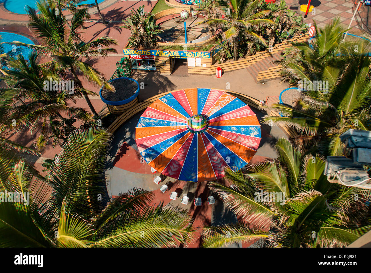Aerial view of amusement park, rides, and arcade on promenade of Golden Mile in Durban, South Africa - Stock Image