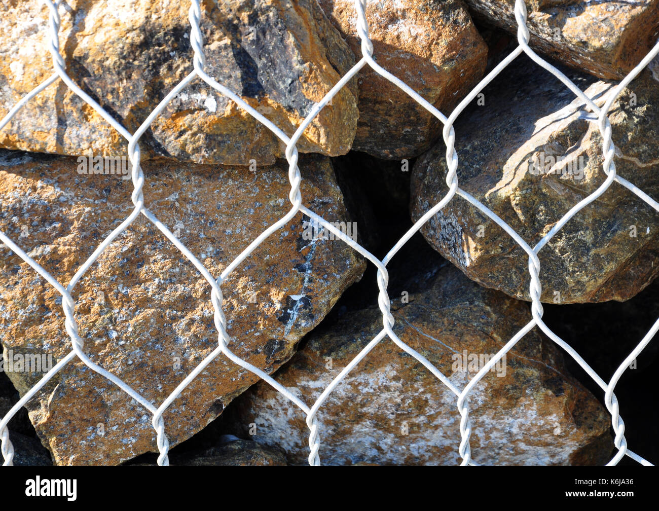 Wire Fence Filled Stones,Stones in metal wire cage - Stock Image