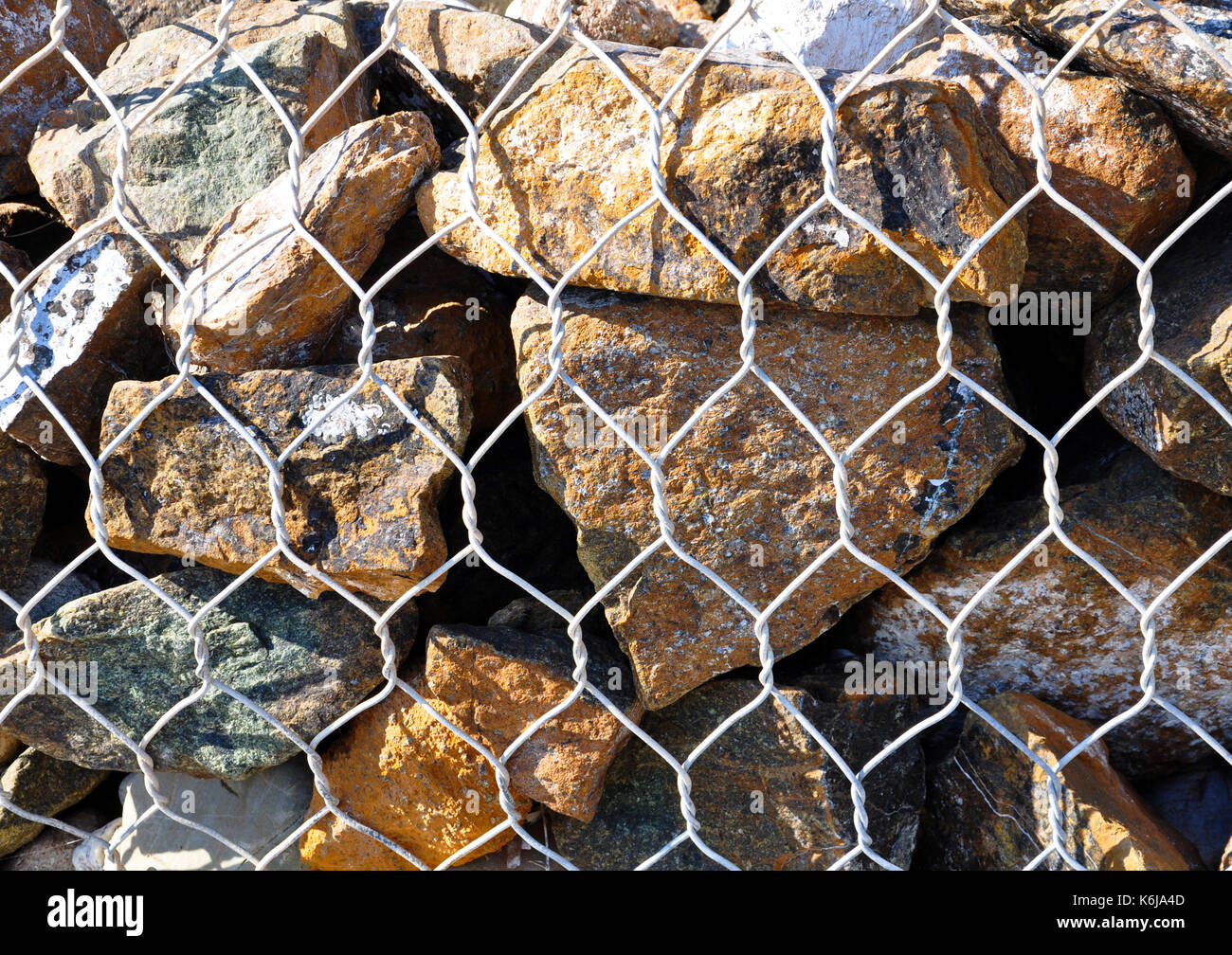 Wire Fence Filled Stones, Stones in metal wire cage - Stock Image