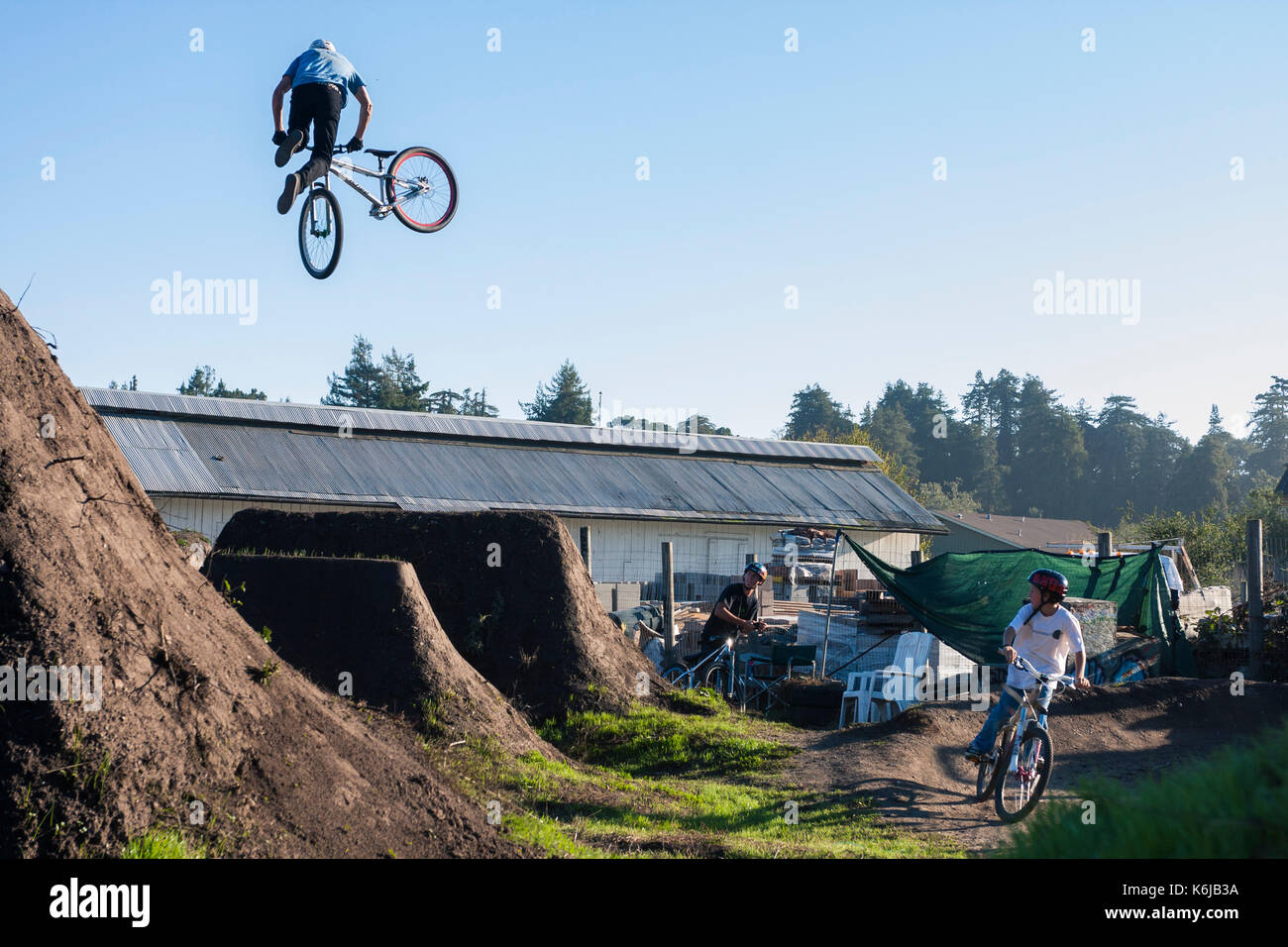 Rider doing bicycle trick mid air, Aptos, California, USA - Stock Image