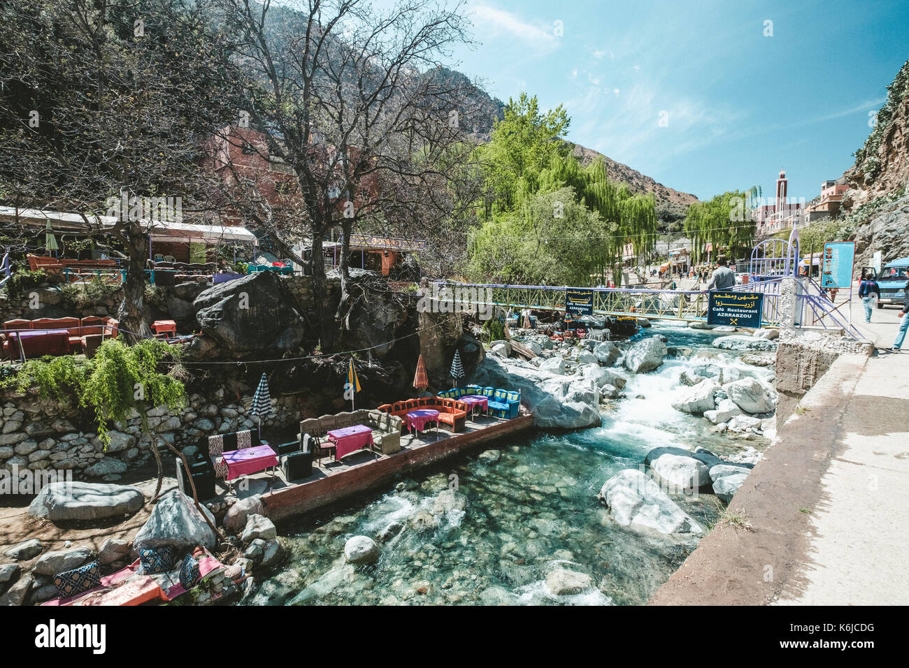 View of Ourika River and restaurants with tables in water, Ourika, Marrakesh Province, Morocco - Stock Image