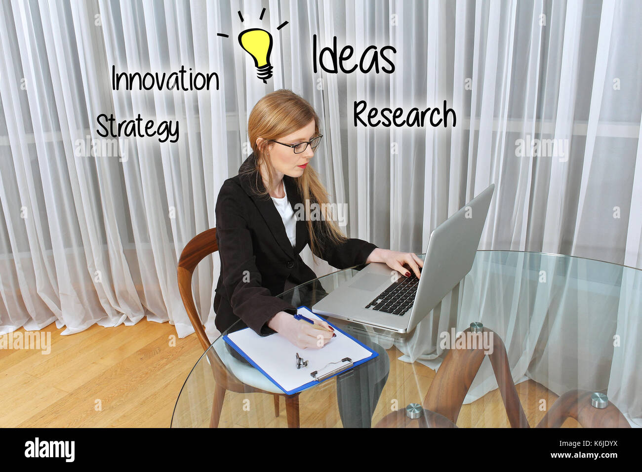 Young Woman Working On Computer With Lightbulb Ideas Drawing Over