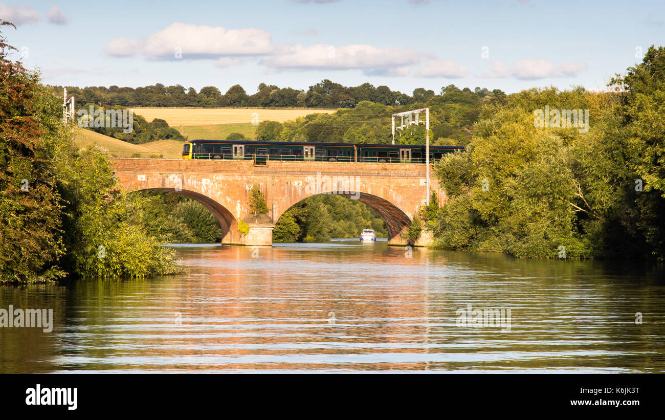 Reading, England, UK - August 29, 2016: Thames Turbo diesel multiple units crossing the River Thames at Goring in Berkshire, under new electrification - Stock Image
