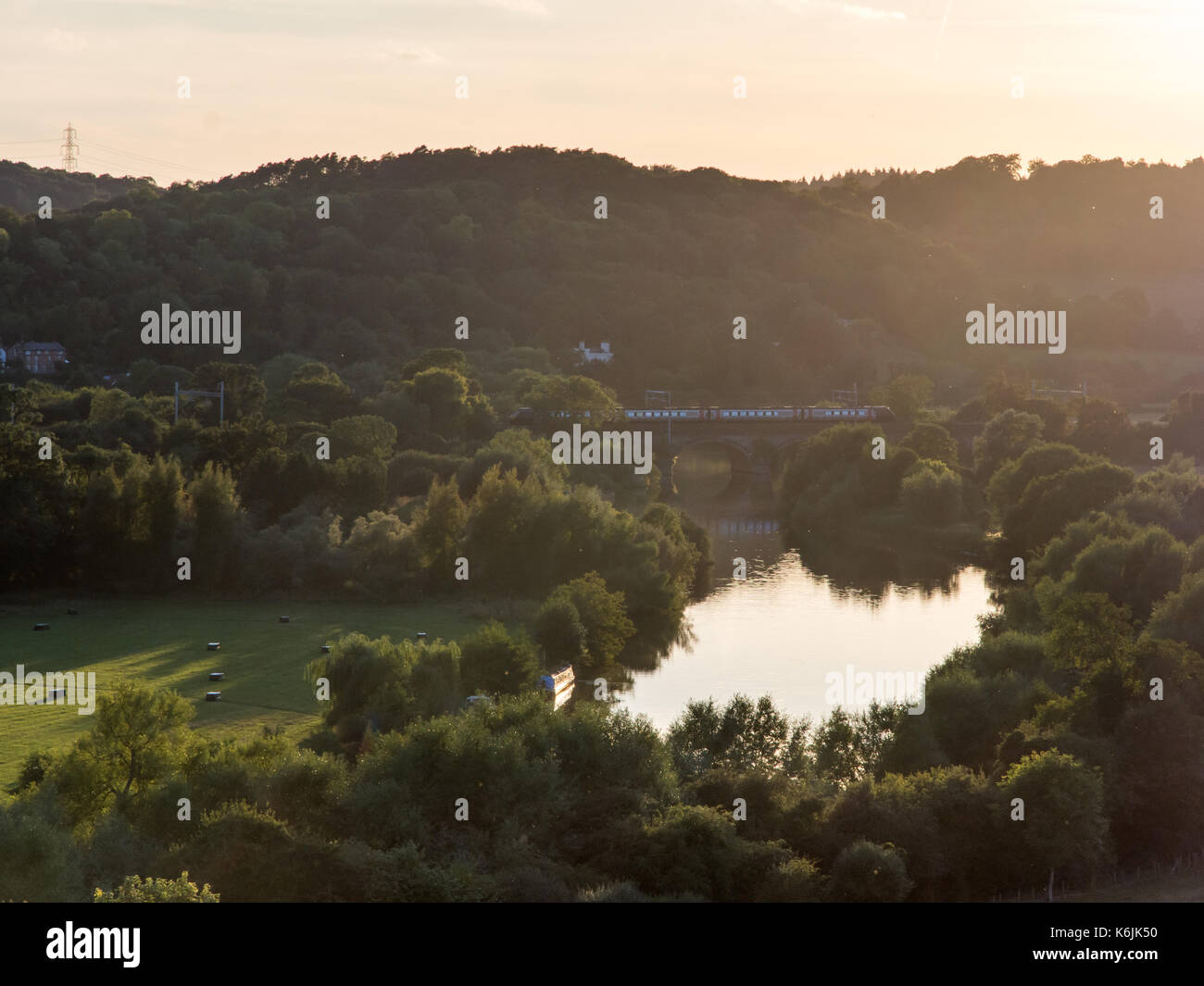 Reading, England, UK - August 29, 2016: A Crosscountry Class 220 Voyager train crosses the River Thames on the Goring Viaduct in the Chiltern Hills we - Stock Image