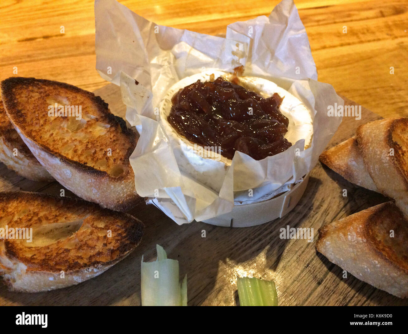 Typical UK's starter - Baked Camembert cheese with onion chutney - Stock Image