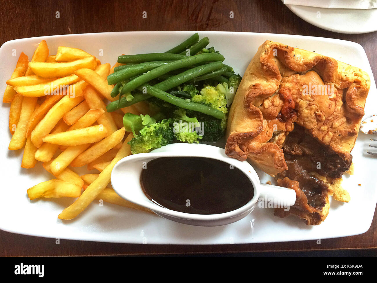 British lunch - Steak pie with chips, broccoli and gravy - Stock Image