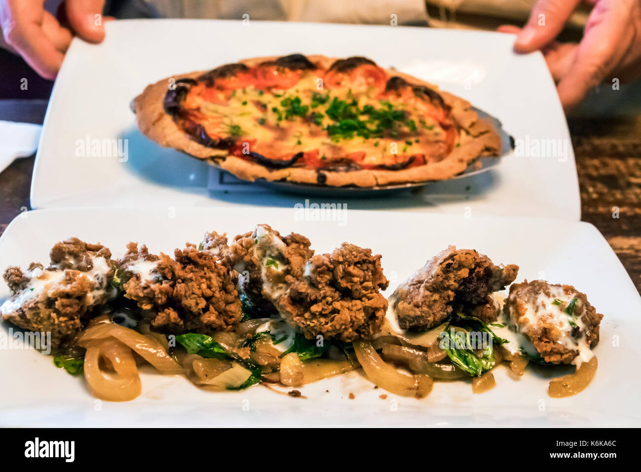 Charleston South Carolina SC Historic Downtown Virginia's On King restaurant southern cuisine dining fried chicken livers tomato pie - Stock Image