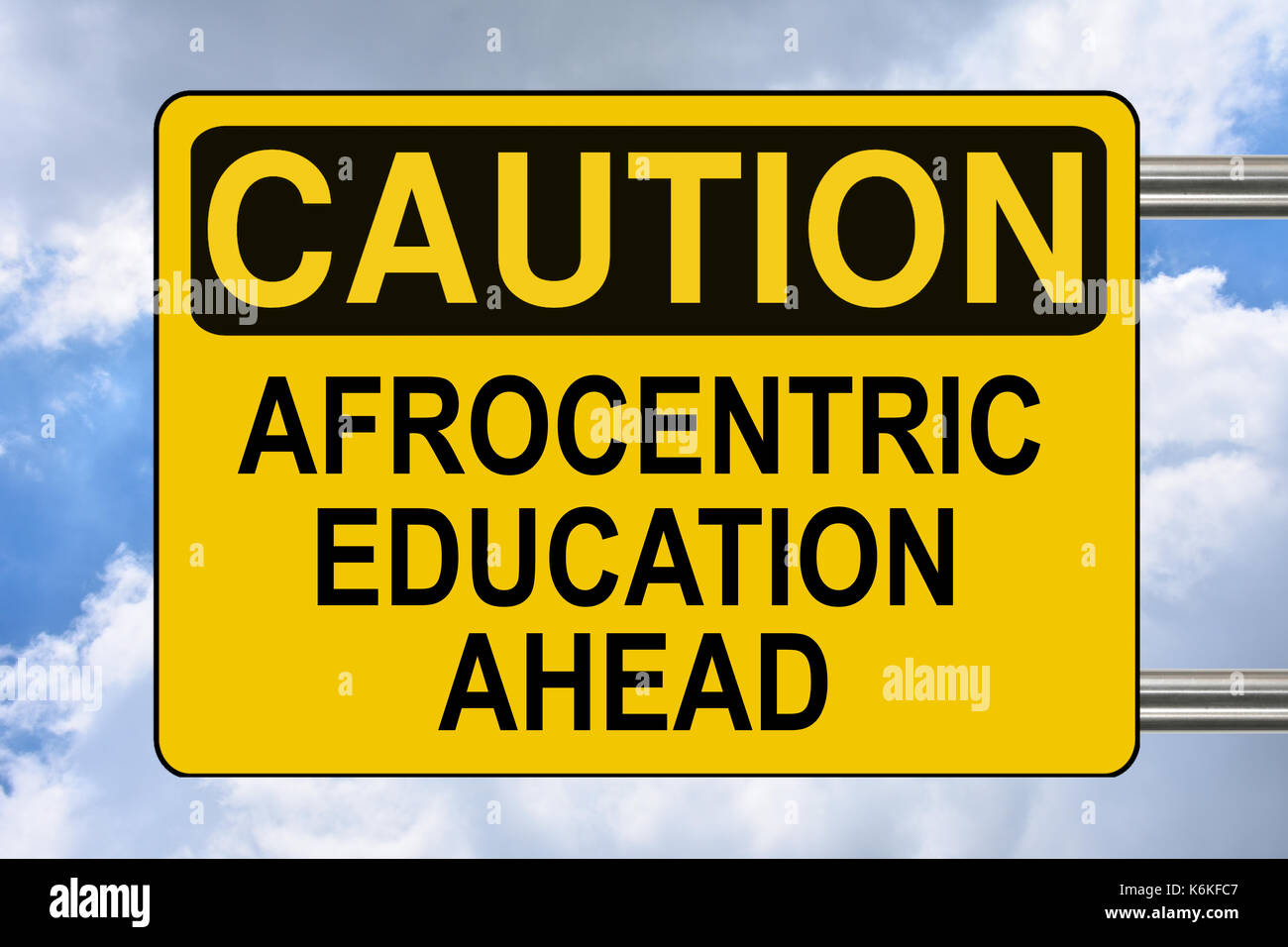 Afrocentric education ahead, educational yellow road sign - Stock Image