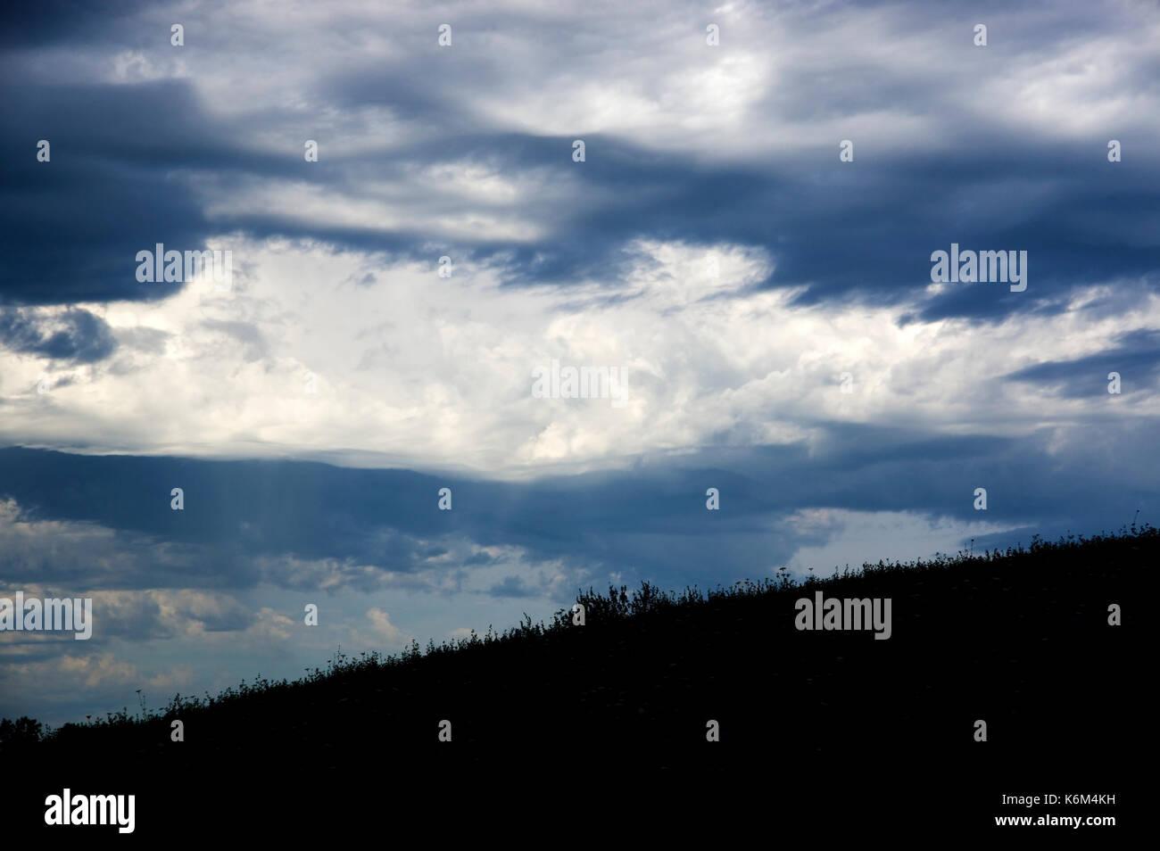 Windblown dark storm clouds approaching - Stock Image