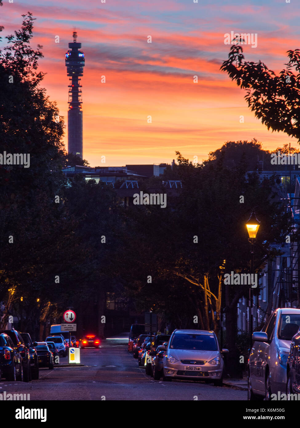 London, England, UK - October 18, 2016: The BT Tower is silhouetted against the sunset viewed from Wharton Street Stock Photo