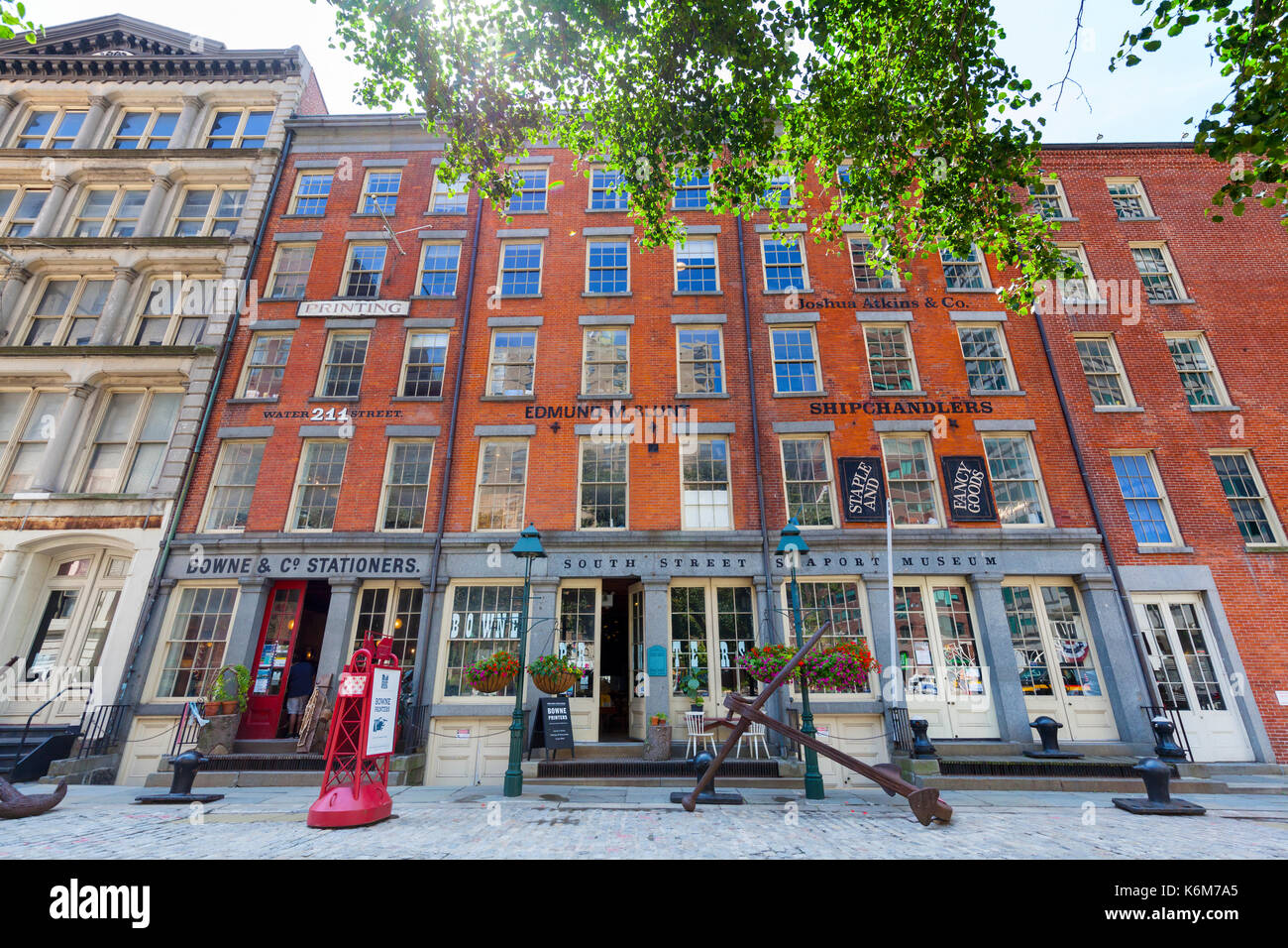 A view of businesses in the South Street Seaport in Lower Manhattan, New York. - Stock Image