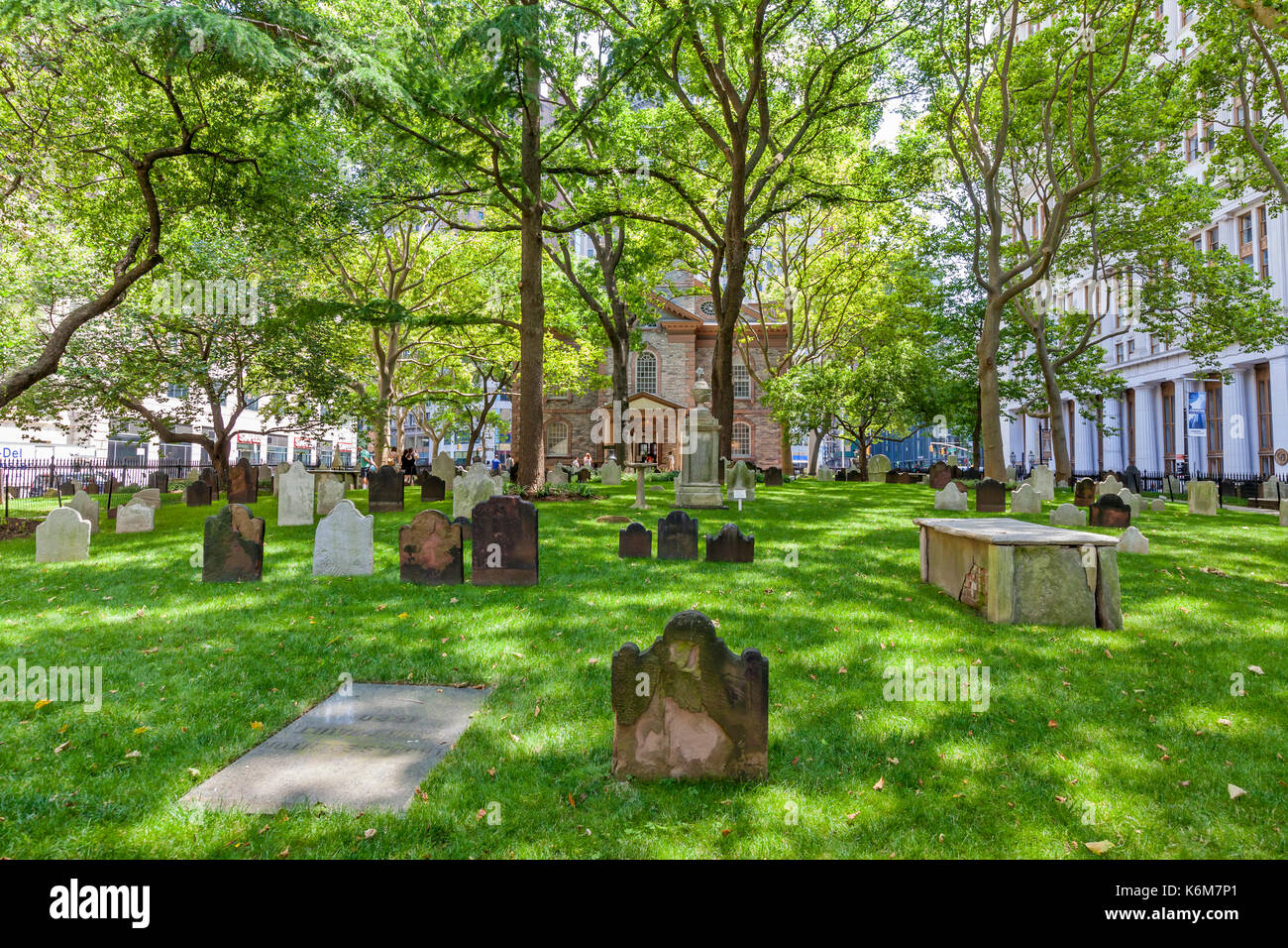 The graveyard, cemetery, behind St. Paul's Churchyard near the Freedom Tower with headstones from the 1700's. - Stock Image