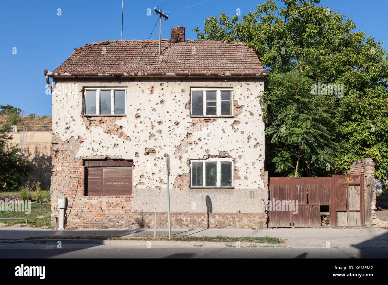 Half ruined and damaged house in the center of Vukovar, Croatia. The city became one of the centers of the 1991-1995 conflict between Serbia and Croat - Stock Image