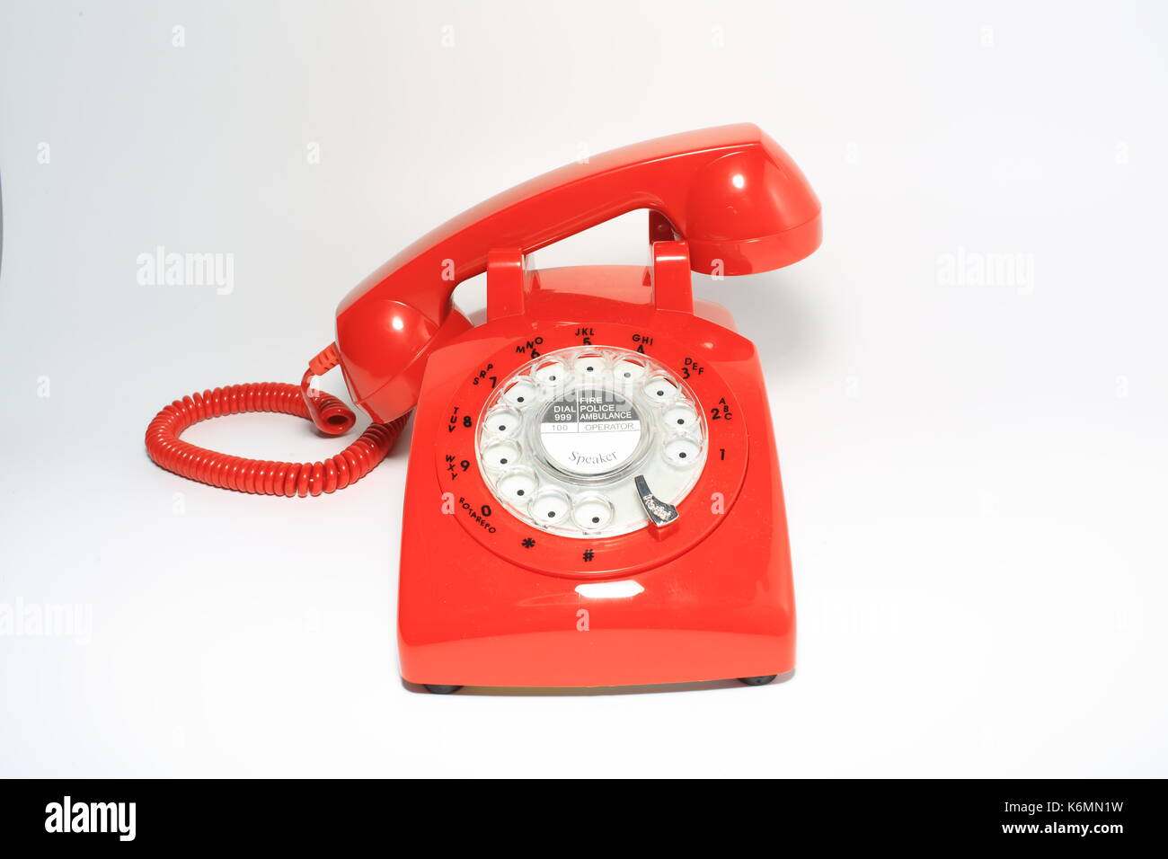 Retro rotary dial phone on call with no body, hang up by hollow man - Stock Image
