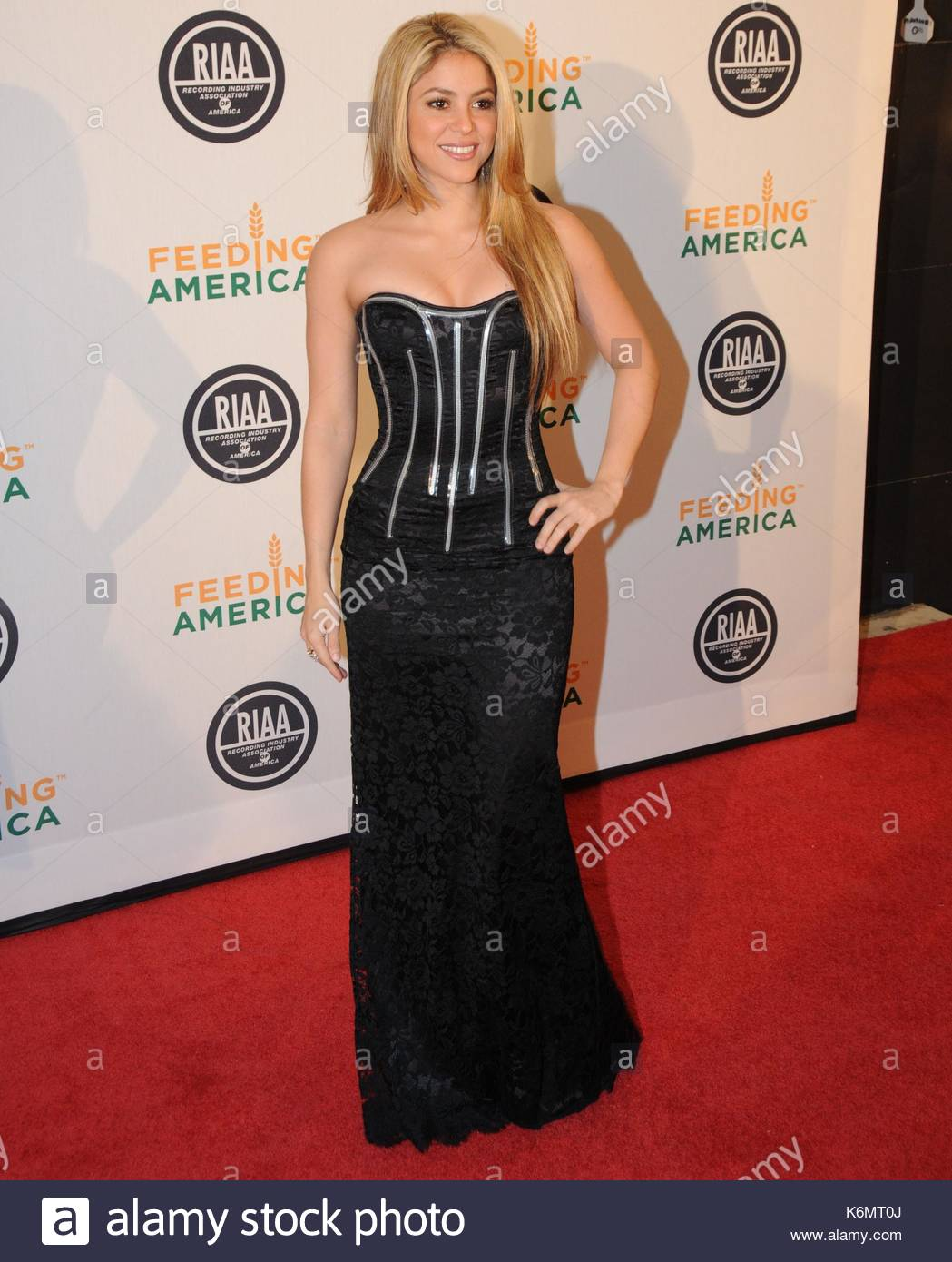 Shakira. Shakira walked the red carpet in a strapless tight black ...