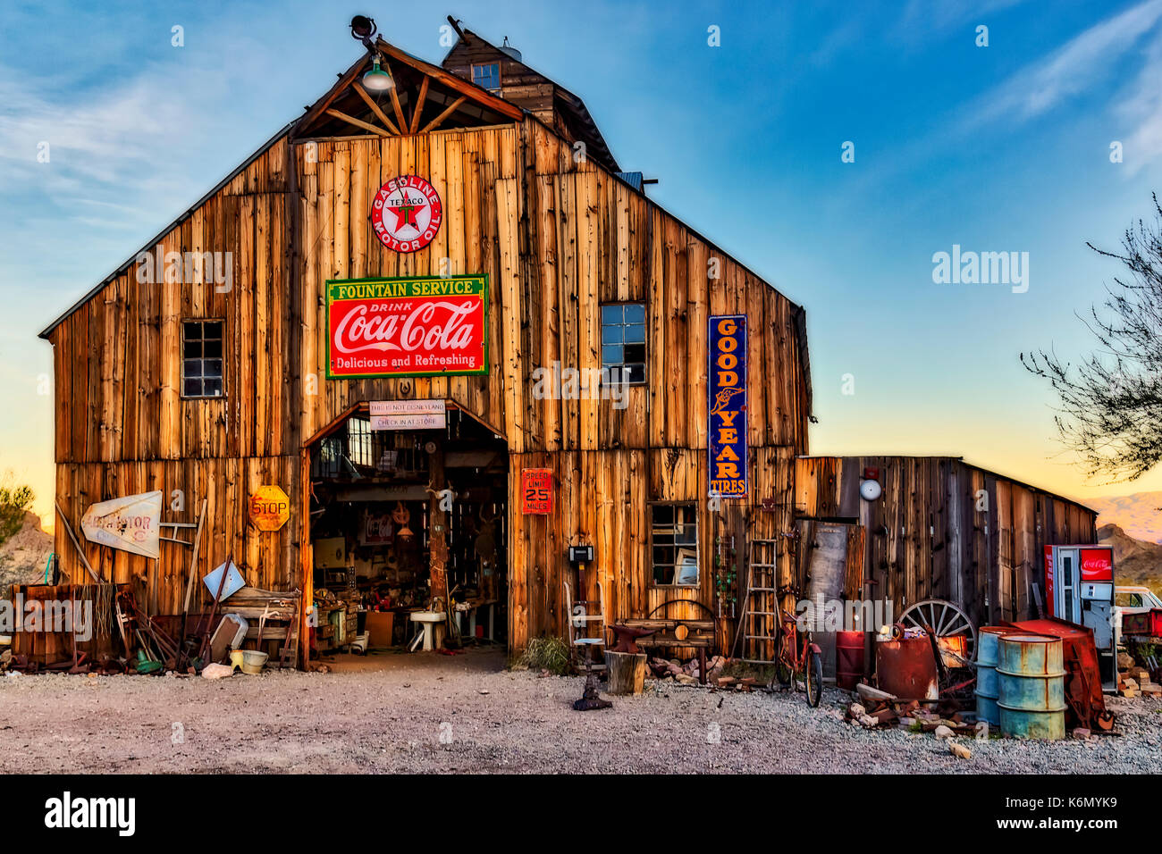 Ghost Town Barn - Vintage barn filled with antiques and signs. Stock Photo