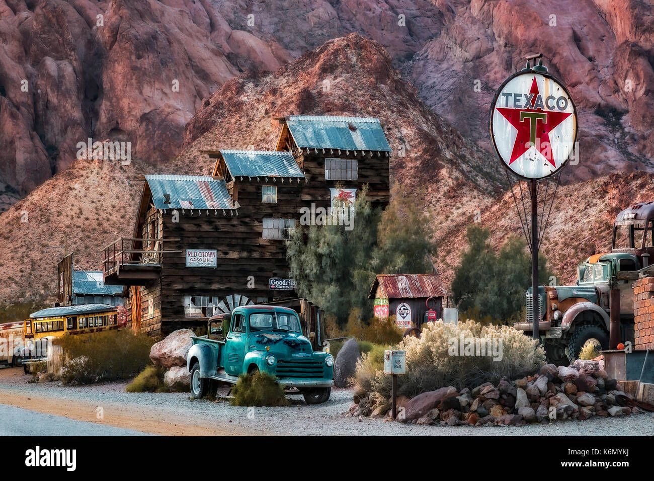 Vintage Texaco Gas Station - Ghost town vintage Texaco Gasoline Station along with a wooden inn and old rusted cars, trucks and buses.  Available in c - Stock Image