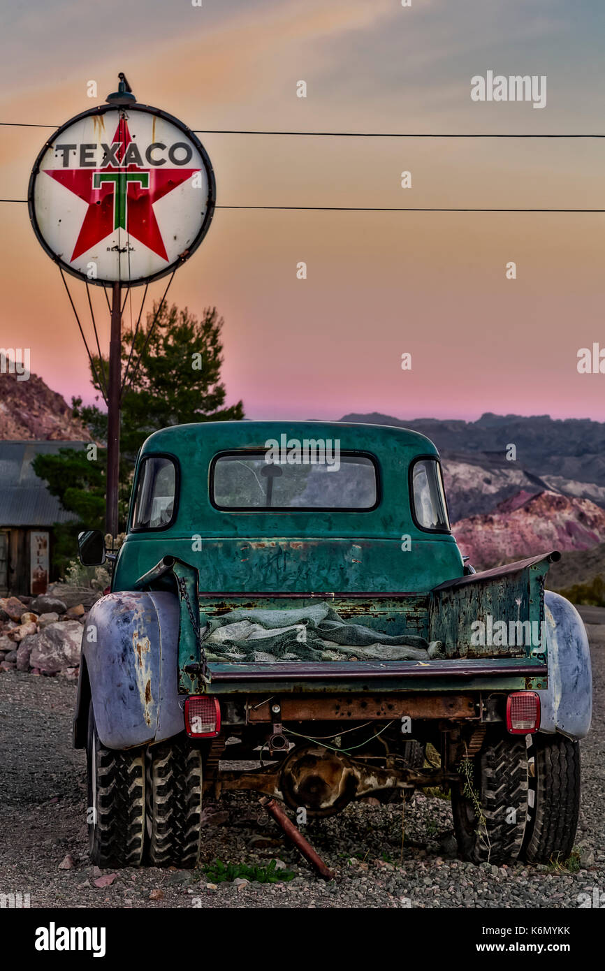 Texaco Gas Station - Vintage Texaco gas station with antique pick up truck during sunset. - Stock Image