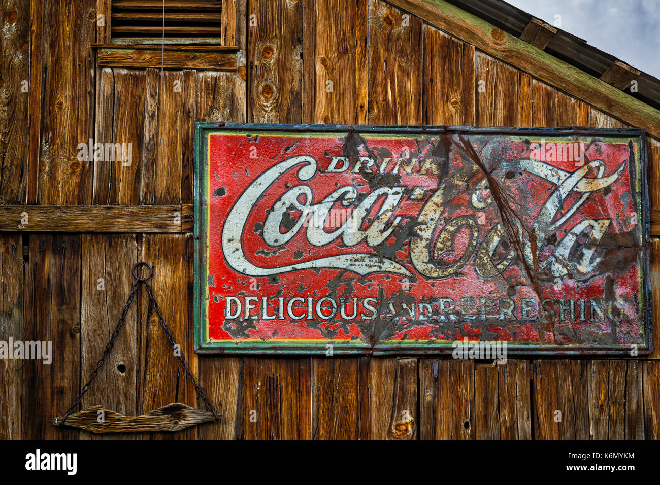Drink Coca Cola Sign - Vintage Drink Coca Cola, Delicious and Refreshing sign against a wooden structure at an American Southwest Ghost town. - Stock Image