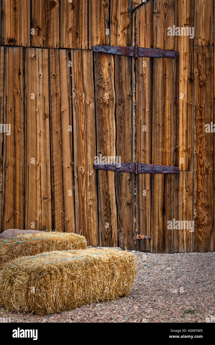 Barn Doors And Hay in an American Southwest Ghost town. - Stock Image