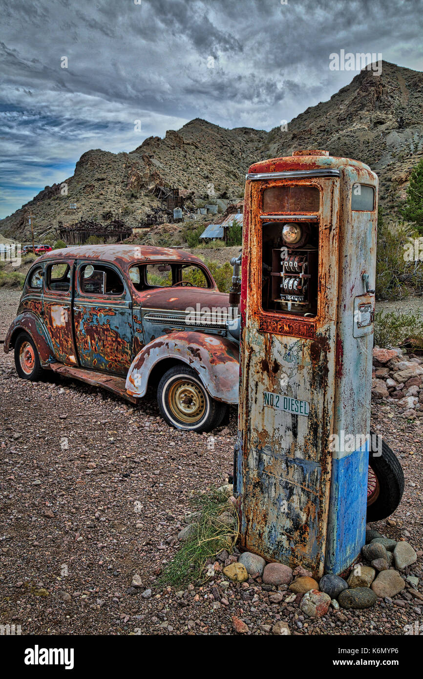 Premium No 2 Diesel Pump - Abandoned old rusted gas pump with an early 1900's Dodge car. - Stock Image