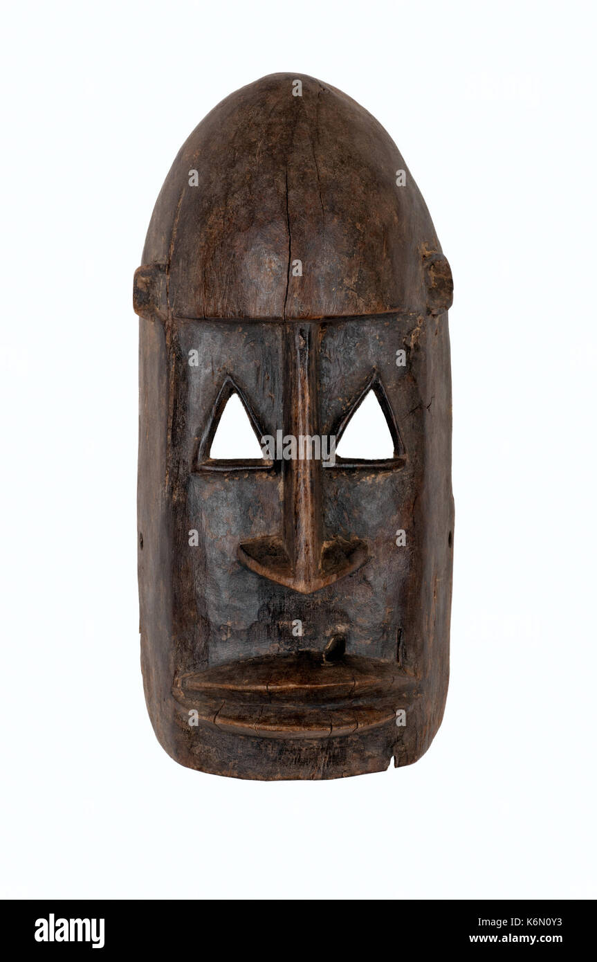 Dogon mask from Mali, carved in wood; small splits, scrapes and cracks attest to its age/use. - Stock Image