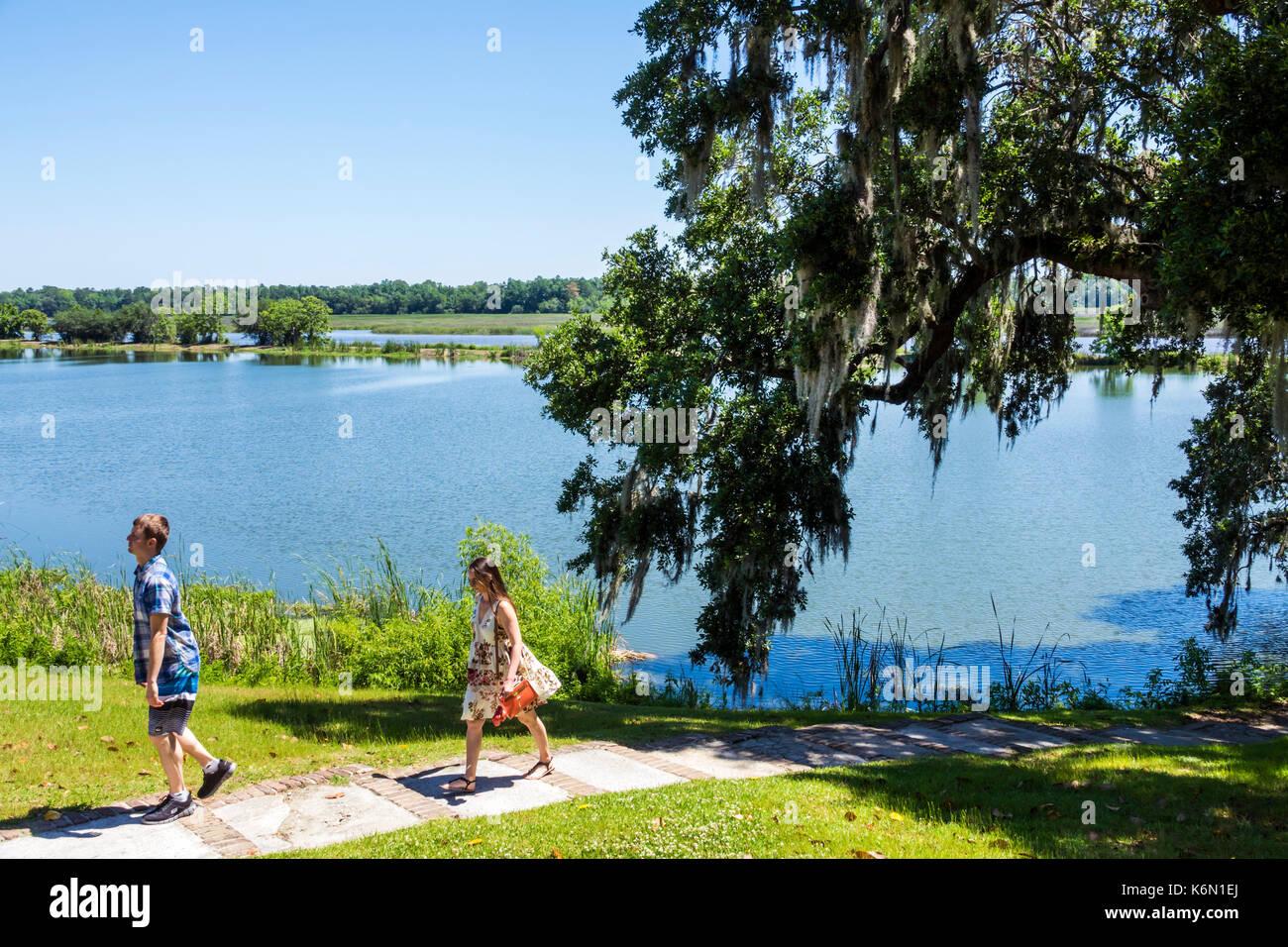 Charleston South Carolina SC Middleton Place National Historic Landmark Ashley River rice plantation antebellum 1730 garden couple exploring - Stock Image