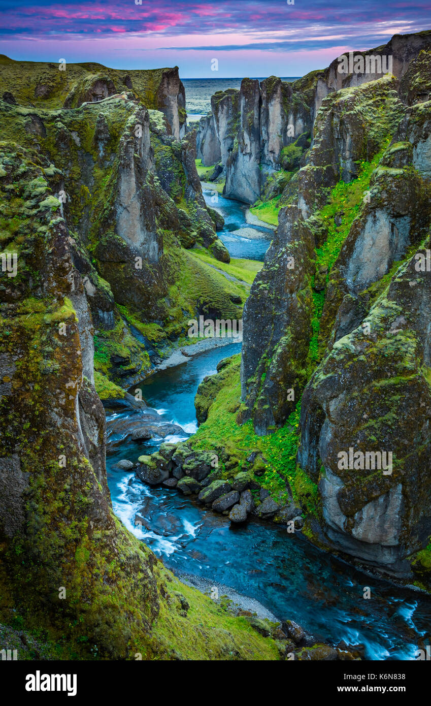 Fjaðrárgljúfur is a canyon in south east Iceland which is up to 100 m deep and about 2 kilometers long, with the Fjaðrá river flowing through it .The  - Stock Image