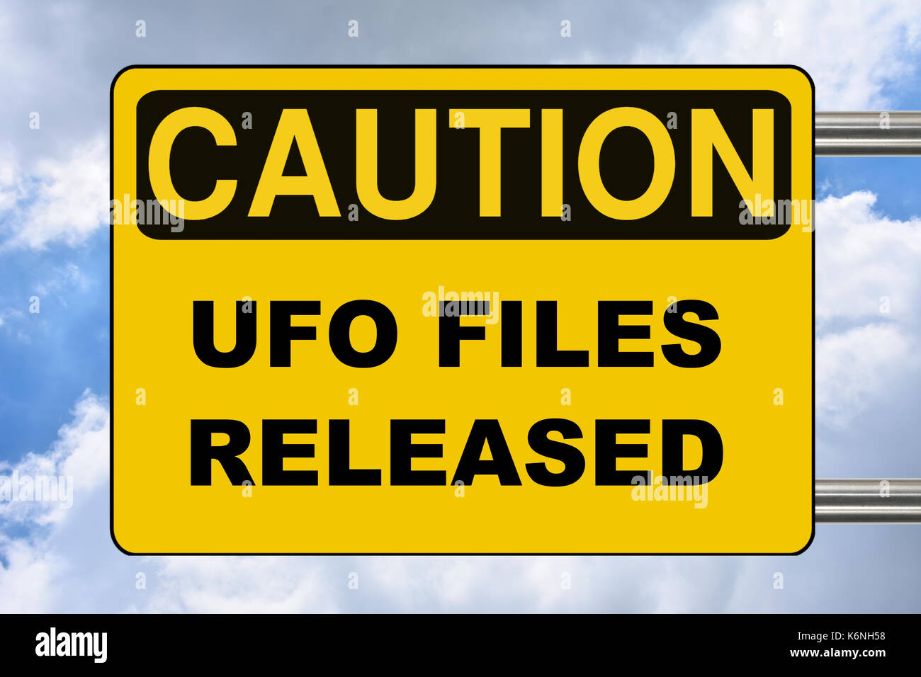 UFO files released, yellow caution street sign - Stock Image