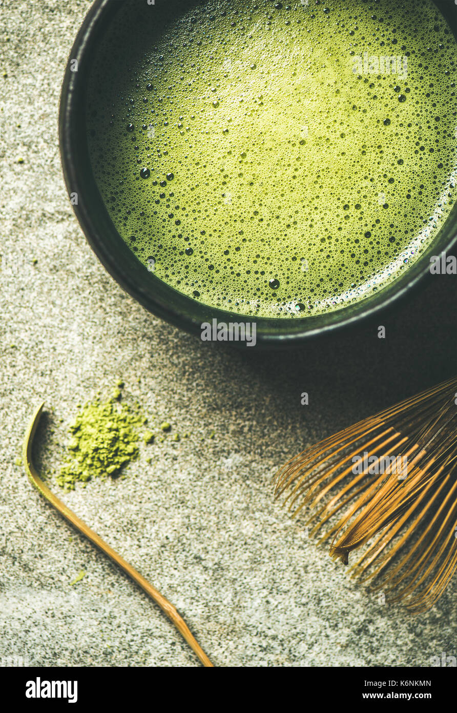 Flat-lay of freshly brewed Japanese matcha tea in Chasen bowl - Stock Image