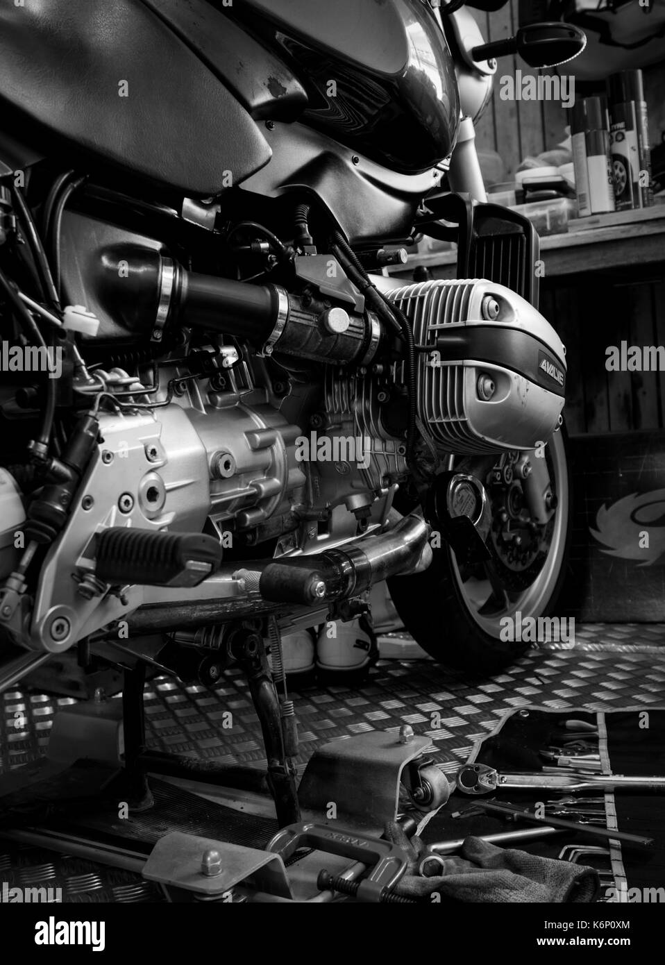 CHONBURI, THAILAND- SEPTEMBER 10, 2017 :Tool on the platform and single cylinder head cover in motorcycle shop,black and white scene, black and white  - Stock Image