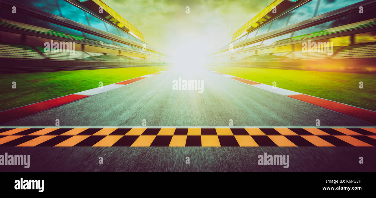 Panorama view of the infinity empty asphalt international race track starting or end line, Motion blurred effect. - Stock Image