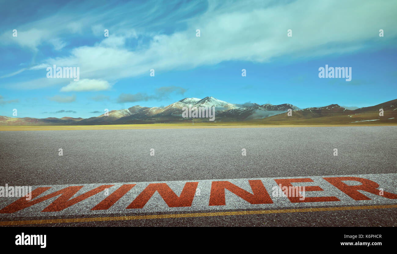 View of the empty asphalt road with winner word and beautiful mountain landscape . Evening scene . - Stock Image