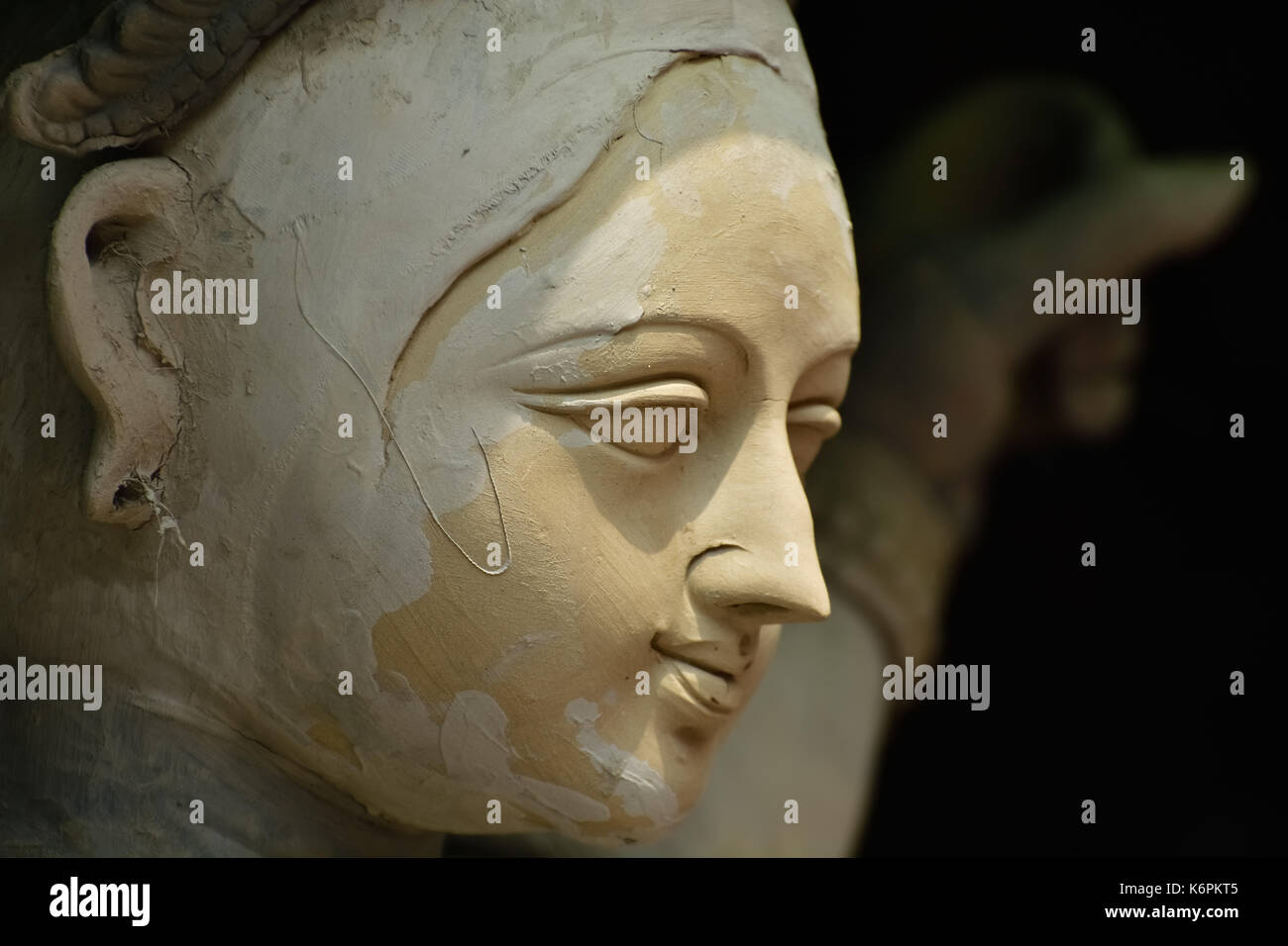 Sculpture of Hindu Goddess Durga. Goddess idols are being prepared with clay before festival. Idols being made for Durga Puja festival. Sculpture of g - Stock Image