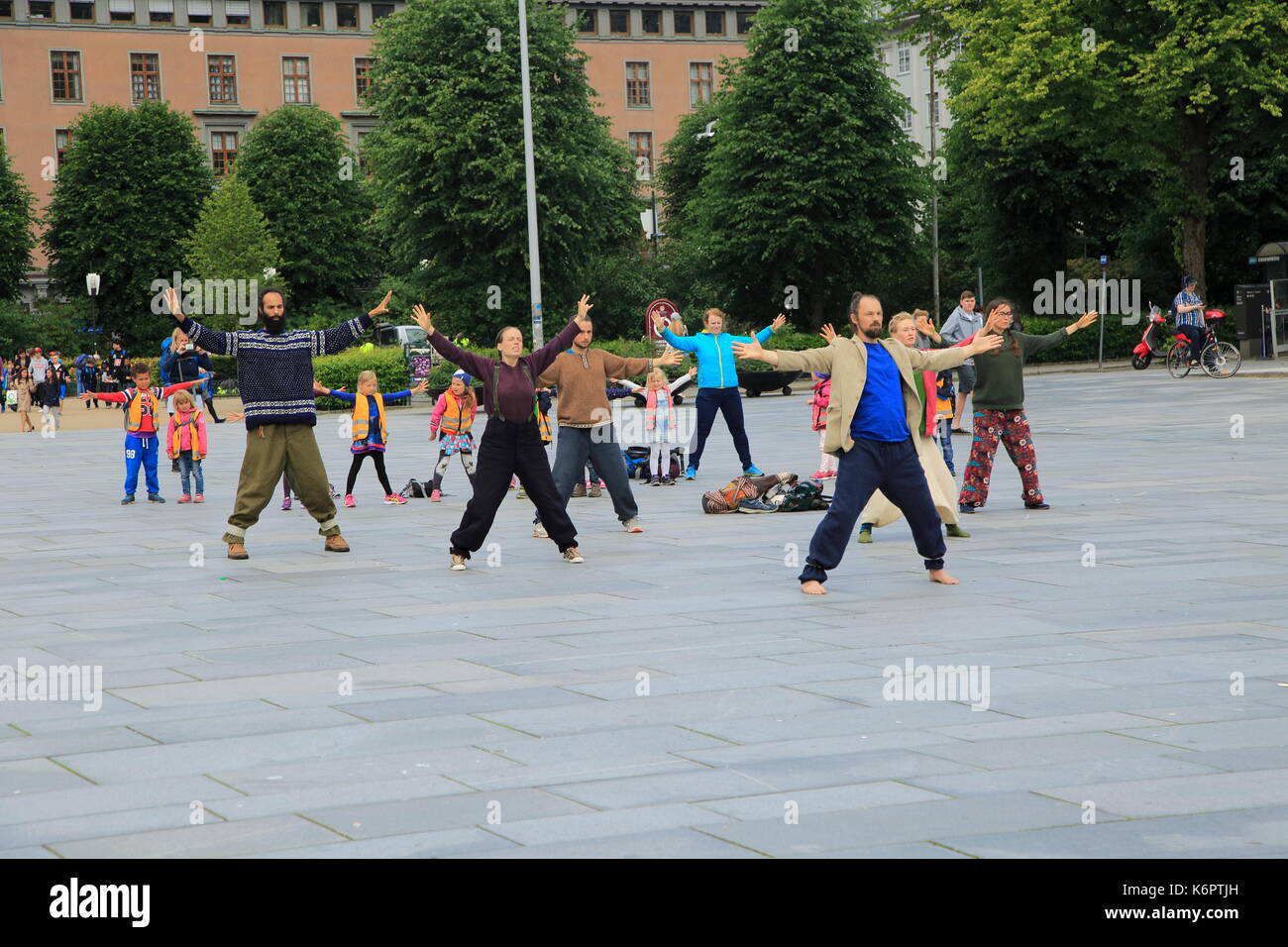 Tai Chi class exercising in public space in city centre, Bergen, Norway - Stock Image