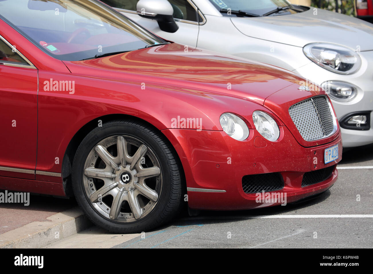 Monte-Carlo, Monaco - May 28, 2016: British Luxury Car Bentley Continental GTC Badly Parked on the Sidewalk in Monaco - Stock Image