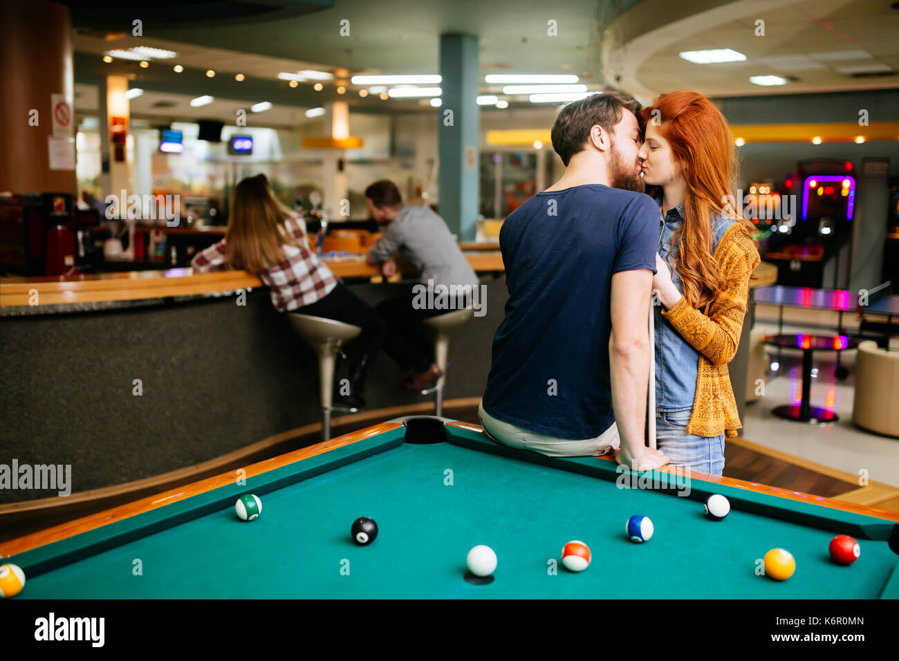 Couple kissing on a date - Stock Image