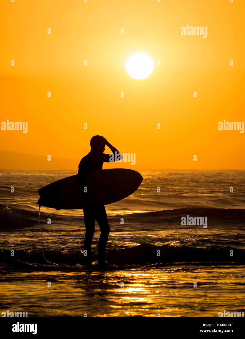 a6c48f1d8b Surfer at sunset Stock Photo  159096668 - Alamy