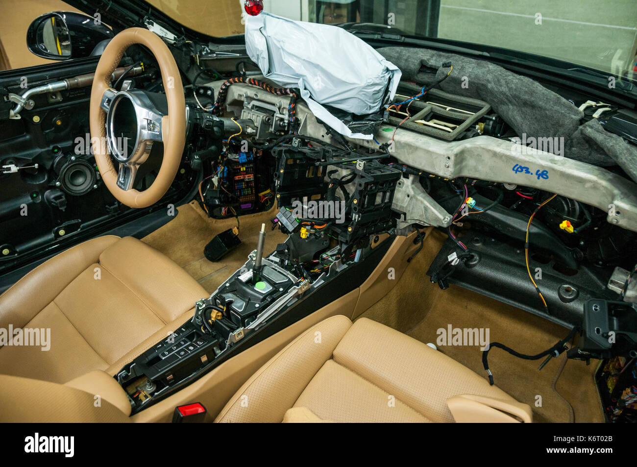 Porsche 911 convertible undergoing interior work at Manthey Motors on the Beijing Tuning Street. - Stock Image